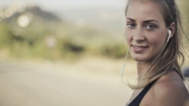 Woman wearing sports top and headphones